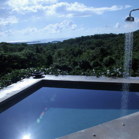 Pool view of the Caribbean and lush surroundings at Casa Angular
